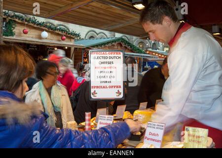 Traditional Festive Dickensian Christmas Festival Street Market Stalls in Manchester, UK - Stock Photo