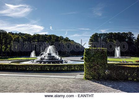 Latona Fountain on grounds of Herrenchiemsee Palace, Herreninsel, Lake Chiemsee, Bavaria, Germany; hot-air balloon - Stock Photo