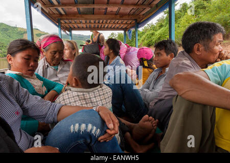 A full boat on the nam Ou river, Laos - Stock Photo
