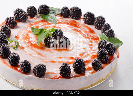 cheese cake with fresh berries on wooden table.. Selective focus - Stock Photo