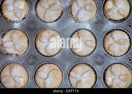 Baking Homemade Christmas mince pies - Stock Photo