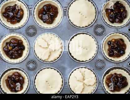 Baking Homemade Christmas mince pies - Stock Photo