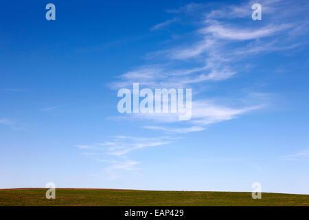 blue sky above prairie fields Saskatchewan Canada - Stock Photo