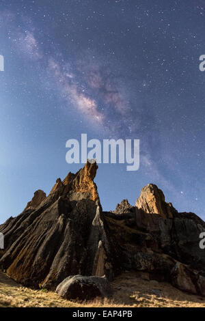 Milky way and moon light lit rocks at Hatun Machay, Cordillera Negra, Andes, Peru, South America - Stock Photo