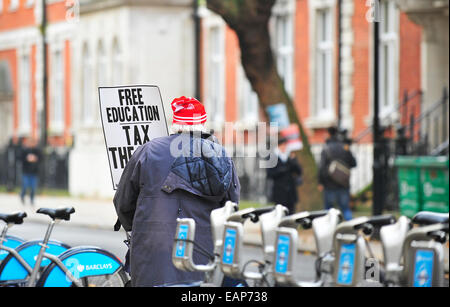 London, UK. 19th November, 2014.  A mature student participates in the march through central London towards Westminster - Stock Photo