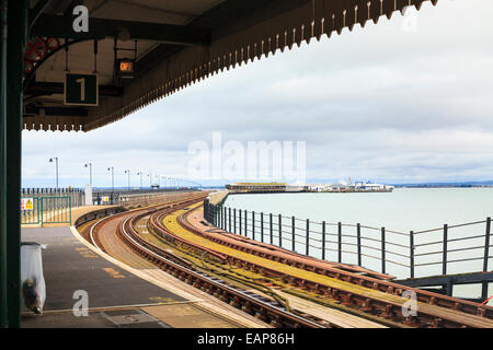 Ryde Pier railway station and tracks along the pier to the ferry - Stock Photo