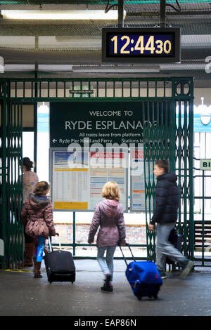 A family enters the Ryde Pier train station on the Isle of Wight - Stock Photo