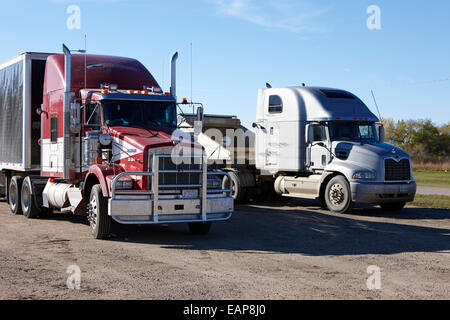 semi trucks in a roadside rest stop rural Saskatchewan Canada - Stock Photo