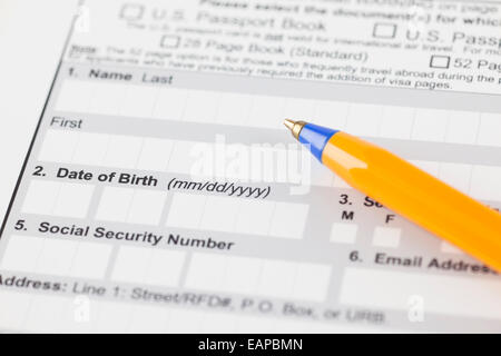 Application form with ballpoint pen. Focus on date of birth. - Stock Photo