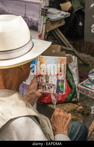 street painter at place du tertre in the montmartre district working on a street scene, paris, ile de france, france - Stock Photo