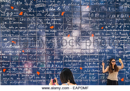asian tourists in front of the so-called i-love-you-wall, buttes montmartre, place des abbesses, square jehan rictus, - Stock Photo