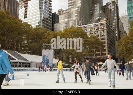 Ice skaters enjoy Bryant Park in midtown Manhattan. NYC - Stock Photo