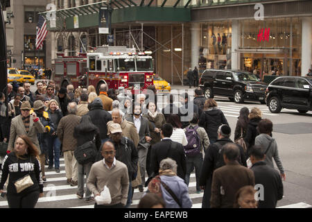 5th Ave. at 42nd Street is one of the most constantly crowded corners in New York City. - Stock Photo