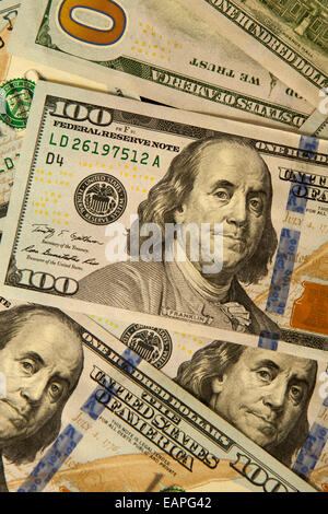 Newest US $100 bills as of 2013 with an embedded magnetic strip among other qualities difficult to forge. - Stock Photo