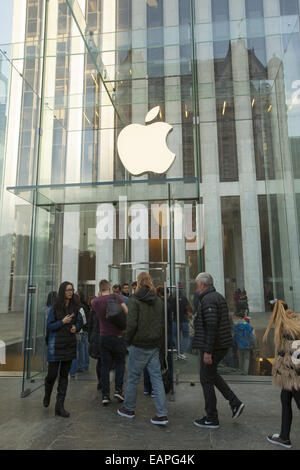 The iconic glass cube Apple Store where customers descend into the store at 59th St. & 5th Ave. in NYC. - Stock Photo