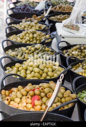 Buckets of Olives at a street vendor's stall. Large buckets of fresh olives entice buyers at this specialty vendor - Stock Photo