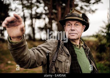The hunter Wolfgang Wernicke in woods of Brandenburg Herzberg (Mark), on Oktober 30, 2014 in Germany. Photo: picture - Stock Photo
