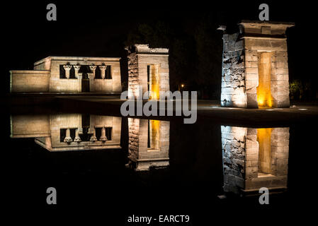 Debod Temple at night with suggestive lights and reflections - Stock Photo