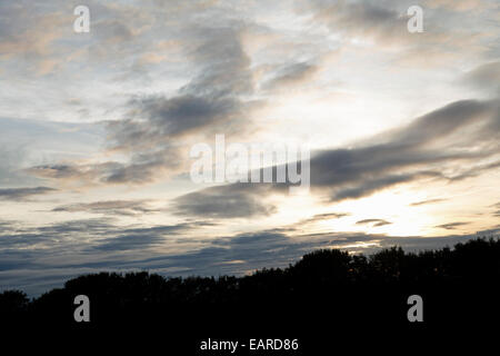 Storm clouds forming as the summer sun sets over Hampshire, England - Stock Photo