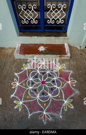 Traditional Rangoli, Kolam or Muggu, decorative pattern made of coloured sand outside a door, Rameswaram, Pamban - Stock Photo