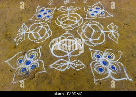 Traditional Rangoli, Kolam or Muggu, decorative pattern made of coloured sand, Rameswaram, Pamban Island, Tamil - Stock Photo