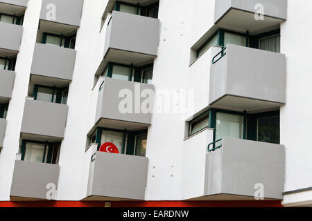 Satellite dish with the symbol of the Turkish flag on the balcony of a residential building, block of flats, Schöneberg, - Stock Photo