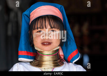 Girl of the Padaung ethnic group wearing traditional clothing, portrait, at Indein, Shan State, Myanmar - Stock Photo