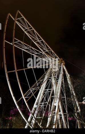 Preparations for Edinburgh's Christmas 2014. The partly-constructed big wheel at night. - Stock Photo