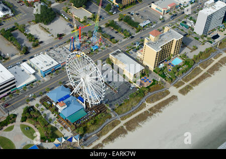 Aerial View of the oceanfront Skywheel, Boardwalk, restaurants, condominiums, resorts and hotels of Myrtle Beach, - Stock Photo