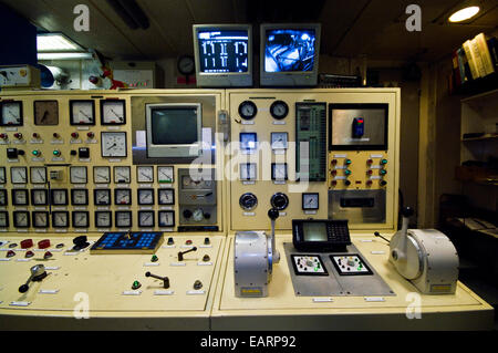 An Antarctic ship's engine control room and dual propeller throttles. - Stock Photo