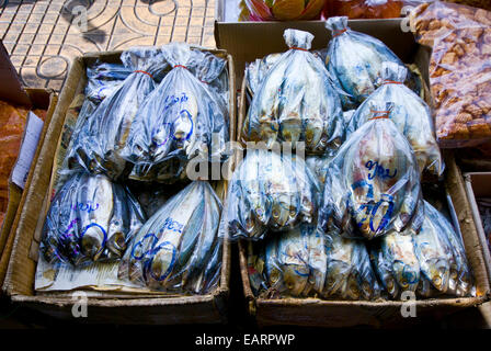 Freshly caught fish for sale in plastic bags in an open air market. - Stock Photo