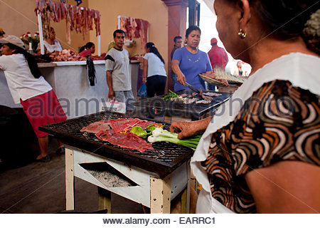 Grilling meat in the Tlacolula market. - Stock Photo