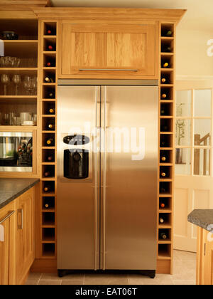 Stainless Steel Fridge And Built In Wine Rack Storage In Kitchen