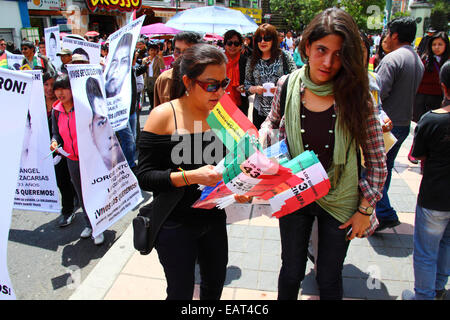 La Paz, Bolivia. 20th November, 2014. Protesters hand out flags with 43 Ayotzinapa on them during a march to demand - Stock Photo