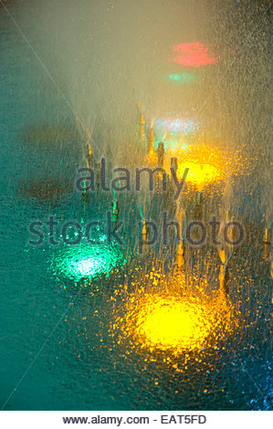 Lotte World Amusement Park's decorative lights shine in a fountain. - Stock Photo
