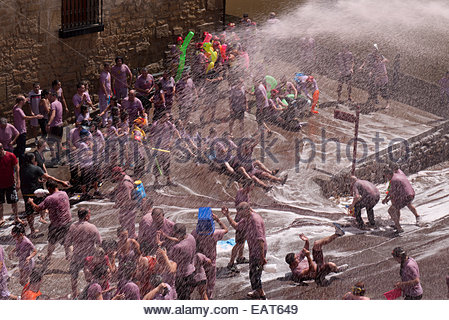 People participating in the Battle of Wine Festival in San Asensio, Spain. - Stock Photo