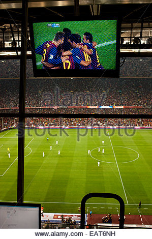 F.C. Barcelona, or Futbol Club Barcelona, is celebrating a goal during a game at the Stadium Camp Nou in Barcelona. - Stock Photo