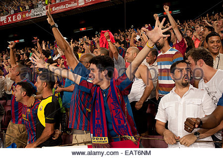 F.C. Barcelona fans at a game at Stadium Camp Nou in Barcelona. - Stock Photo