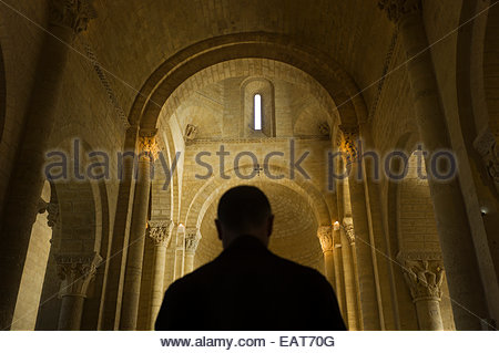 A man at the Church of St. Martin de Tours in Formista, Spain. - Stock Photo
