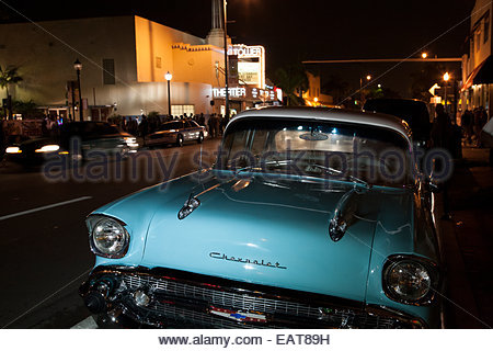 A blue Chevrolet is parked by Tower Theater in Little Havana. - Stock Photo