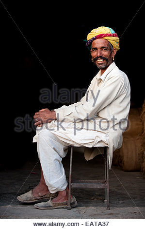 A Rajasthani man with a typically large moustache and bright turban. - Stock Photo