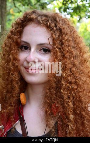 colorful young woman at 2014 Fantasy Fair Arcen Netherlands - Stock Photo