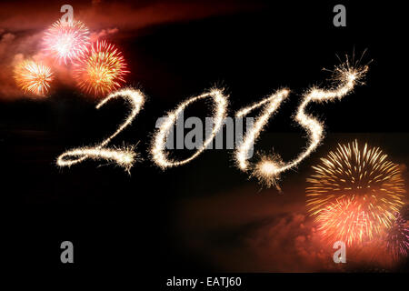 Fireworks against a black background surrounding 2015 written in sparklers representing  celebrating the New Year. - Stock Photo