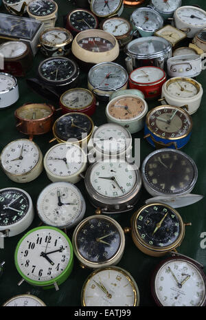 collection of vintage alarm clocks on display at Lille Braderie 2014 - Stock Photo