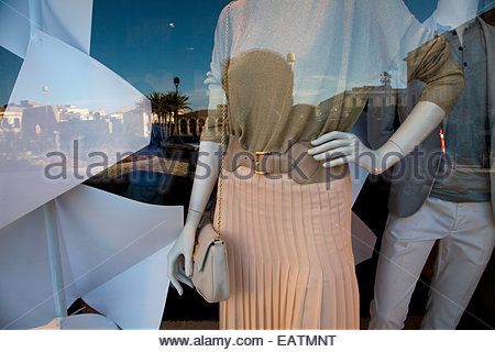 Clothing store window display on the island of Ortygia in Siracusa, Sicily. - Stock Photo