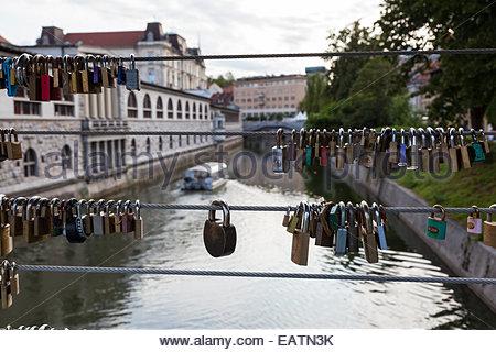 Padlocks placed by couples in love on Butcher's Bridge/Mesarski Most. - Stock Photo