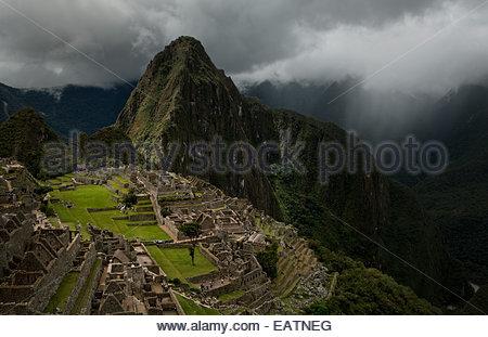 A view of Machu Picchu from aboard the Hiram Bingham luxury train. - Stock Photo