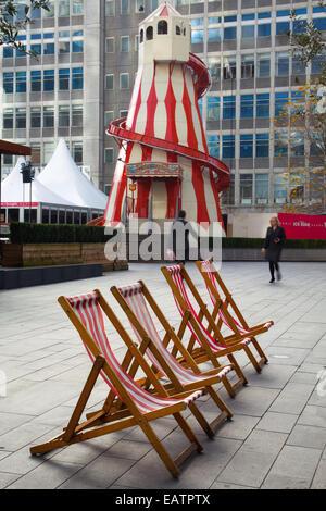 Old traditional wooden Helter-Skelter, a Childrens's fairground spiral slide, at Manchester UK, 20th November, 2014. - Stock Photo