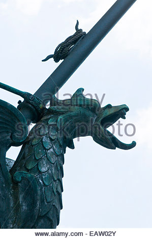 A dragon flag holder with a green patina in Baltimore, Maryland. - Stock Photo