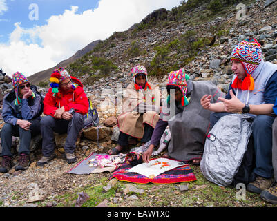 A Quechua priest prepares an offering to the spirits of the Andes Mountains, at Lago Humantay, near Soraypampa, - Stock Photo